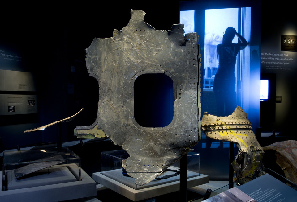 Photo - In this May 5, 2014 photo released by the National September 11 Memorial Museum, a piece of airplane damaged in the attacks of September 11, 2001, is displayed at the New York museum. The long-delayed museum will be dedicated during a ceremony Thursday, May 15, 2014. (AP Photo/National September 11 Memorial Museum, Jin Lee)