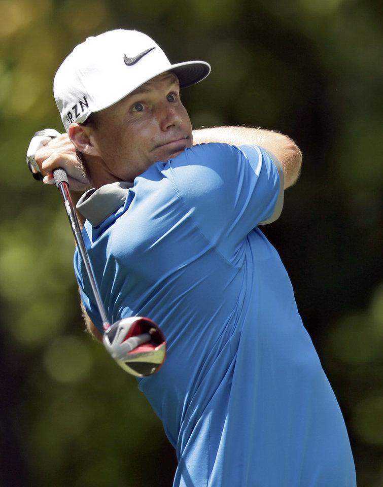 Photo - Nick Watney watches his tee shot on the second hole during the third round of the Wyndham Championship golf tournament in Greensboro, N.C., Saturday, Aug. 16, 2014. (AP Photo/Chuck Burton)