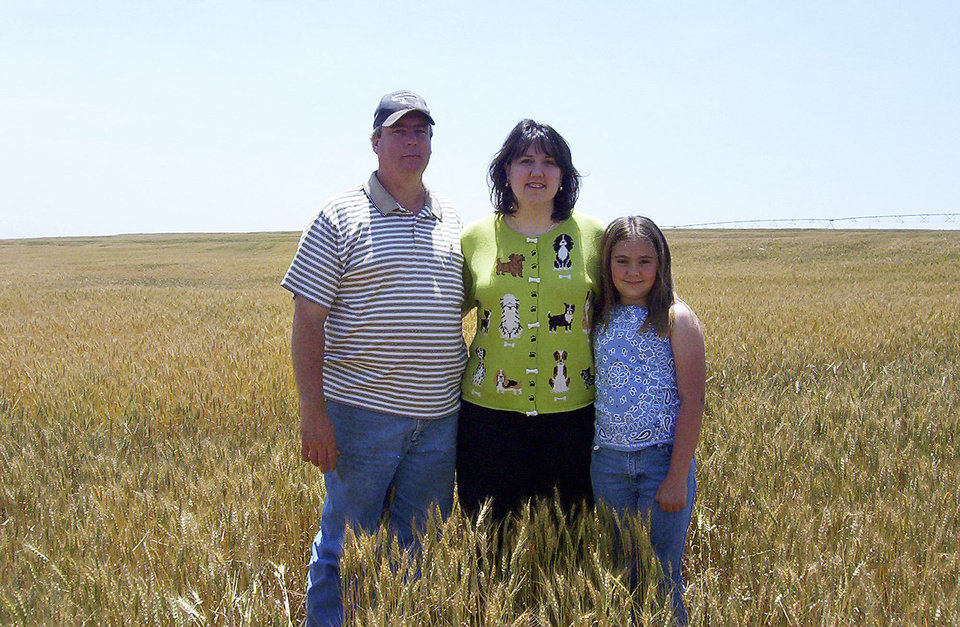 Jeff, Karen and Brittany Krehbiel are shown in a wheat field in 2005.  Jeff battled brain cancer and died in 2011.  <strong>Photo Provided - THE OKLAHOMAN, Archives</strong>