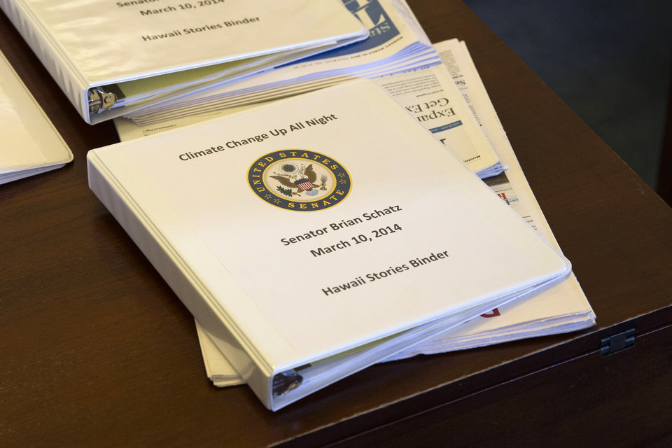 Photo - A binder containing climate change talking points and information for Sen. Brian Schatz, D-Hawaii, sits on a desk before a meeting of the Senate Climate Action Task Force prior to taking to the Senate Floor all night to urge action on climate change on Monday, March 10, 2014, in Washington. (AP Photo/ Evan Vucci)