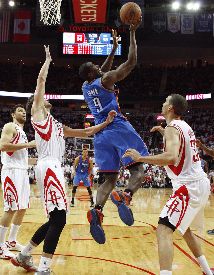 Oklahoma City\'s Serge Ibaka (9) goes to the basket between Houston\'s Chandler Parsons (25) and Francisco Garcia (32) during Game 3 in the first round of the NBA playoffs between the Oklahoma City Thunder and the Houston Rockets at the Toyota Center in Houston, Texas, Sat., April 27, 2013. Oklahoma City won 104-101. Photo by Bryan Terry, The Oklahoman