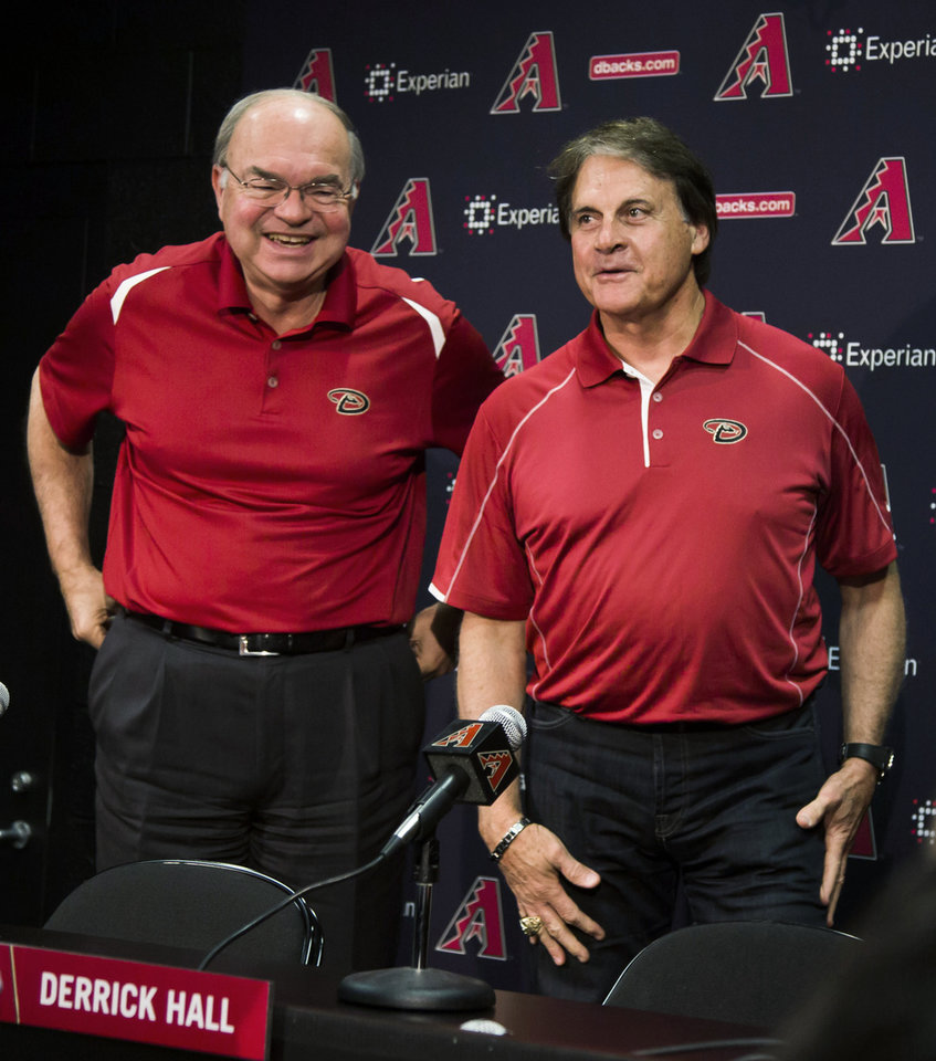 Photo - Arizona Diamondbacks managing general partner Ken Kendrick, left, and Tony La Russa get up after a news conference Saturday, May 17, 2014, in Phoenix, Arizona. The Diamondbacks hired La Russa as chief baseball officer. (AP Photo/The Arizona Republic, Stacie Scott) MESA OUT  MARICOPA COUNTY OUT  MAGS OUT  NO SALES