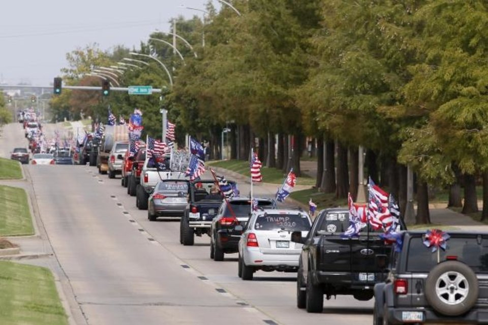 Photo -  Vehicles travel south on Lincoln Boulevard during a MAGA DRAG the Interstate event organized by the Facebook group #Drivefor45 Oklahoma. Supporters were asked to drive 40 miles on the interstate system around Oklahoma City. [Bryan Terry/The Oklahoman]
