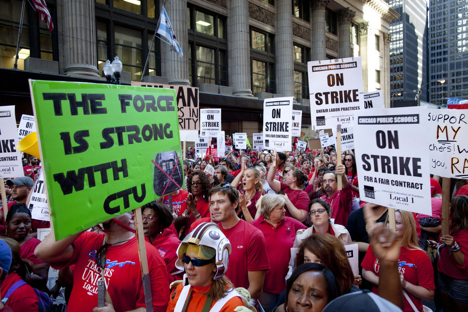 Photo -   Thousands of public school teachers rally outside the Chicago Public Schools district headquarters on the first day of strike action over teachers' contracts on Monday, Sept. 10, 2012 in Chicago. For the first time in a quarter century, Chicago teachers walked out of the classroom Monday, taking a bitter contract dispute over evaluations and job security to the streets of the nation's third-largest city — and to a national audience — less than a week after most schools opened for fall. (AP Photo/Sitthixay Ditthavong)