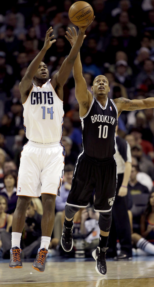 Charlotte Bobcats' Michael Kidd-Gilchrist (14) tries to grab a pass away from Brooklyn Nets' Keith Bogans (10) during the second half of an NBA basketball game in Charlotte, N.C., Wednesday, March 6, 2013. The Nets won 99-78. (AP Photo/Bob Leverone)