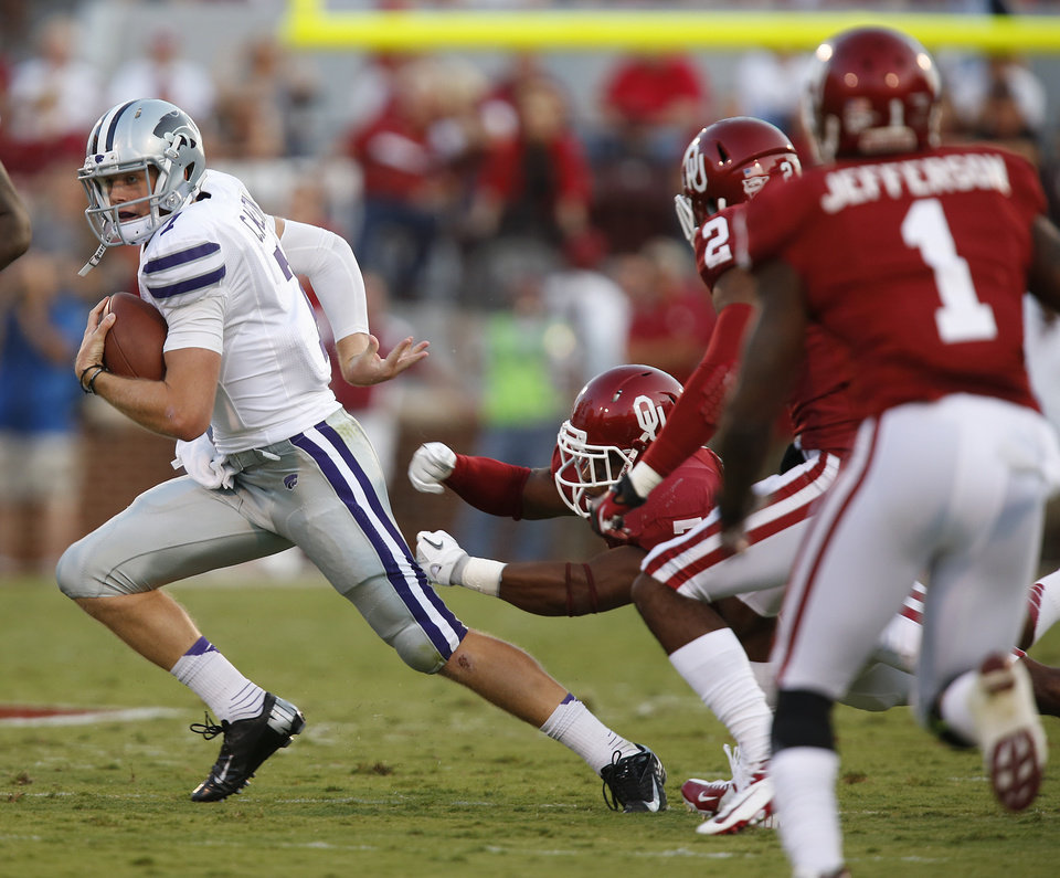 Photo - Kansas State's Collin Klein (7) runs past the Sooner defense during the college football game between the University of Oklahoma Sooners (OU) and the Kansas State University Wildcats (KSU) at the Gaylord Family-Memorial Stadium on Saturday, Sept. 22, 2012, in Norman, Okla. Photo by Chris Landsberger, The Oklahoman