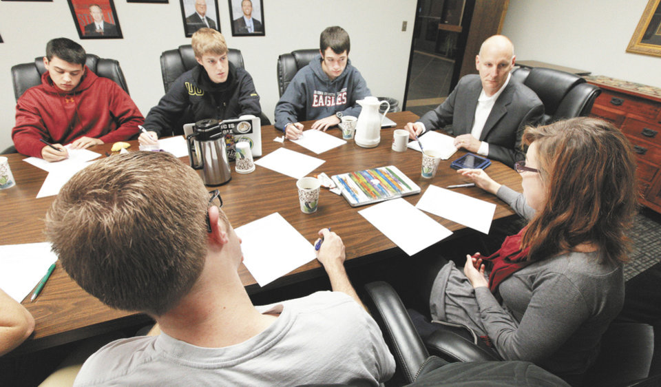 Hannah Ketring, far right, speaks on a topic as members of the ethics team at Oklahoma Christian University meet on the OC campus in Oklahoma City Thursday, Nov. 7, 2013. On the far side are Hunter Farhat, Salida, Calif., Jasper Bawcom, Hillsboro, Oregon, Gabriel Gasiorowski, Milwaukee, Wisconsin, and associate professor Jeff Simmons. Foreground are Chas Carter, Allen, Texas, and Hannah Ketring, Nashville, Tenn.  Photo by Paul B. Southerland, The Oklahoman