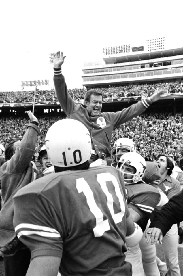 Photo - FILE - This Jan. 1, 1973 file photo shows Texas coach Darrell Royal being carried off the field by his players after the Longhorns defeated the University of Alabama, 17-13, in the Cotton bowl in Dallas, Tex. The University of Texas says former football coach Darrell Royal, who won two national championships and a share of a third, has died. He was 88. UT spokesman Nick Voinis on Wednesday, Nov. 7, 2012 confirmed Royal's death in Austin.(AP Photo/File)