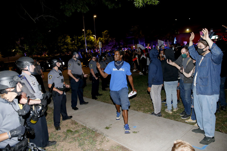 Photo - Protesters gather outside the Oklahoma City Police Department in Oklahoma City, Saturday, May 30, 2020. The protest was in response to the death of George Floyd. [Bryan Terry/The Oklahoman]