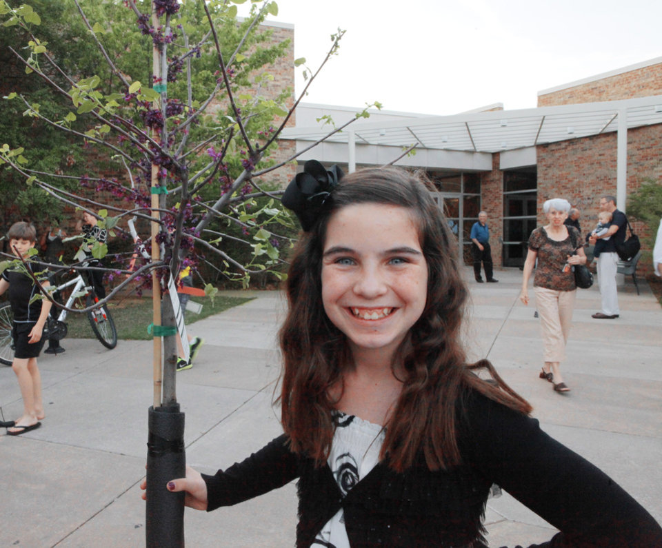 John Ross fifth-grader Olivia Leonard poses with her tree she won for her first place-winning art at Edmond's celebration of Arbor Week at the Edmond Library, March 26, 2012.  Photo By David McDaniel/The Oklahoman