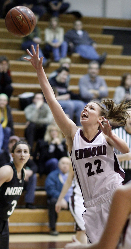 Edmond Memorial's Alie Decker shoots the ball as Norman North's Kiana Moridi during a girls high school basketball game at Edmond Memorial on Friday, Jan. 14, 2011. Photo by Bryan Terry, The Oklahoman ORG XMIT: KOD