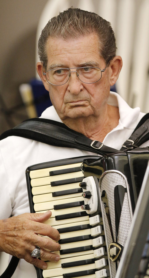 Photo -  Dick Albreski plays at the Oklahoma City Accordian Club meeting. He says he does not like accordion jokes. Photo by Doug Hoke, The Oklahoman   DOUG HOKE