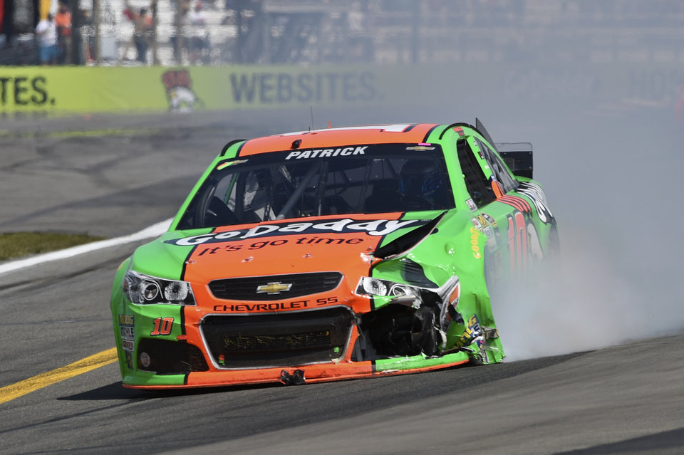 Photo - Danica Patrick (10) drives her wrecked race car during a NASCAR Sprint Cup Series auto race at Watkins Glen International, Sunday, Aug. 10, 2014, in Watkins Glen N.Y. (AP Photo/Derik Hamilton)