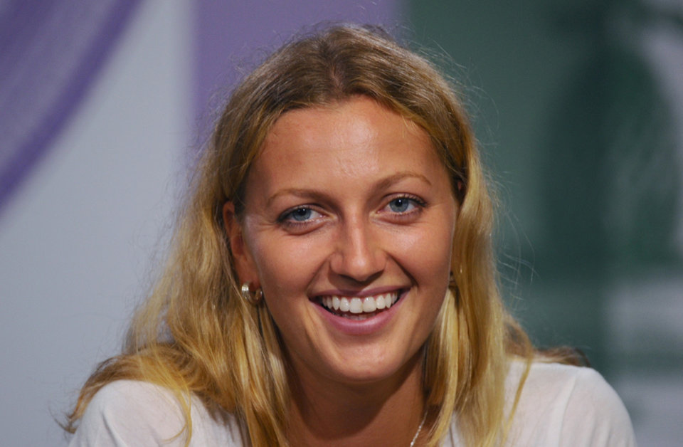 Photo - Petra Kvitova of Czech Republic attends a press conference after winning the 2014 women's singles final against Eugenie Bouchard of Canada at the All England Lawn Tennis Championships in Wimbledon, London, Saturday, July 5, 2014. (AP Photo/AELTC, Javier Garcia)