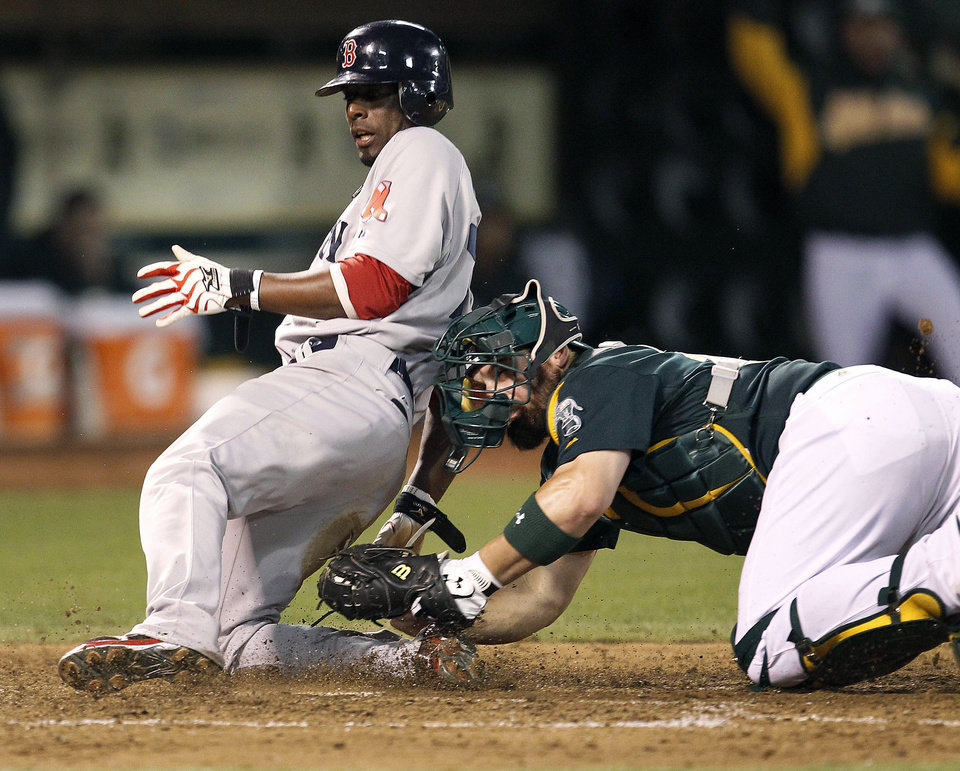 Photo -   Boston Red Sox' Pedro Ciriaco (77) slides safely into home plate past the tag of Oakland Athletics catcher Derek Norris (36) in the sixth inning of a baseball game Saturday, Sept. 1, 2012 in Oakland, Calif. (AP Photo/ Tony Avelar)
