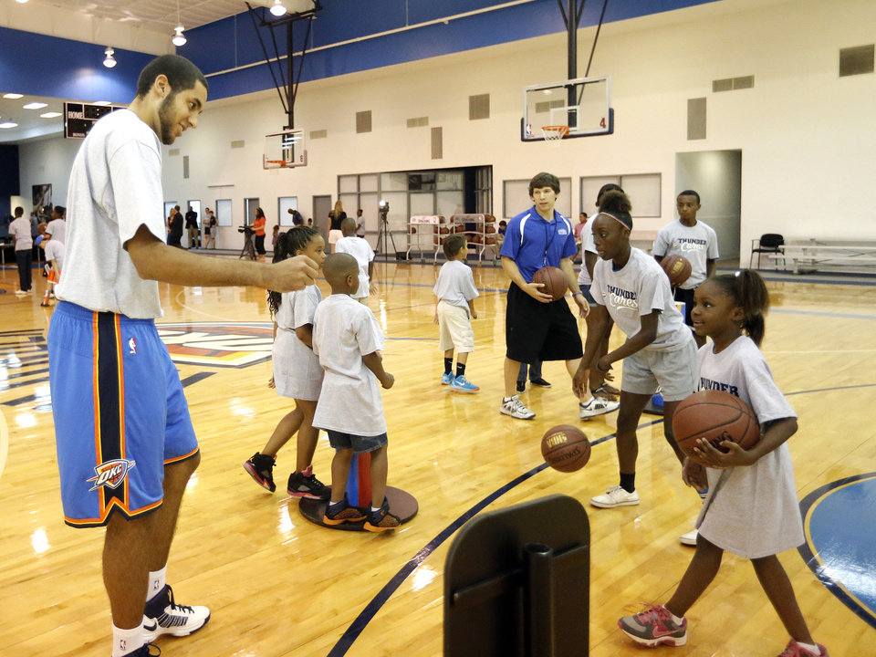Photo - Grant Jerrett participates in drills during the Thunder Youth Basketball mini-camp following a press conference at the Thunder Events center, Saturday, July 29, 2013. Photo by Sarah Phipps, The Oklahoman