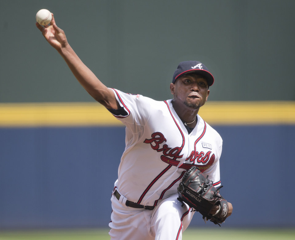 Photo - Atlanta Braves starting pitcher Julio Teheran (49) works against the Philadelphia Phillies in the first inning of a baseball game Monday, Sept. 1, 2014, in Atlanta. (AP Photo/John Bazemore)