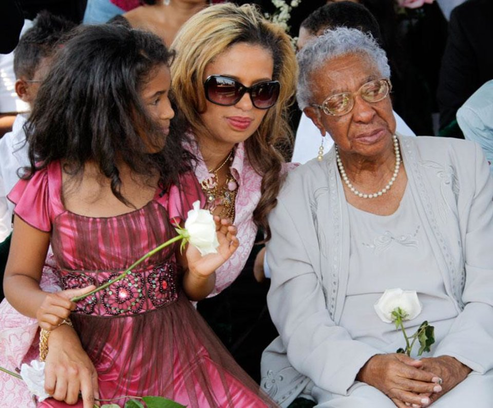 From left, Sasha Wilson, 8, granddaughter of Clara Luper, Chelle Luper Wilson, daughter of Clara Luper, and Oneita Brown, sister of Clara Luper, sit together during the graveside memorial service for civil rights activist Clara Luper at the Hillcrest Memorial Gardens cemetery in Spencer, Okla., Friday, June 17, 2011.  Luper was 88 years old when she died on June 8, 2011. Photo by Nate Billings, The Oklahoman