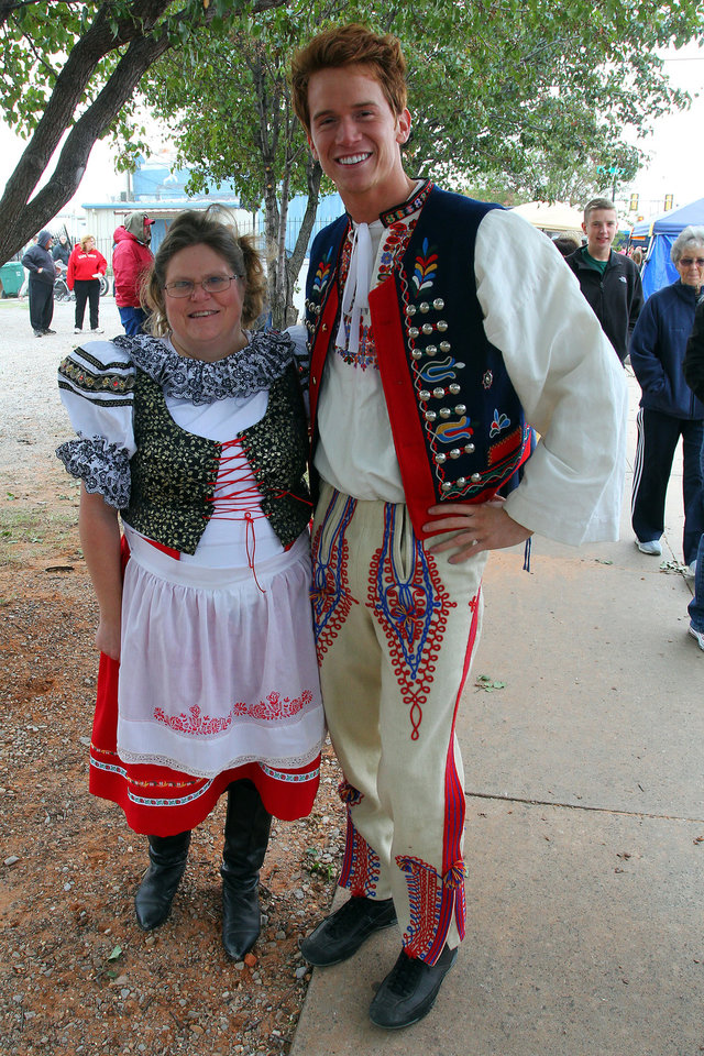 Photo - Stacey Ratcliff of Yukon and Karl Francel of Piedmont wear traditional clothing during the 47th annual Czech Festival Saturday in Yukon. PHOTO BY HUGH SCOTT FOR THE OKLAHOMAN