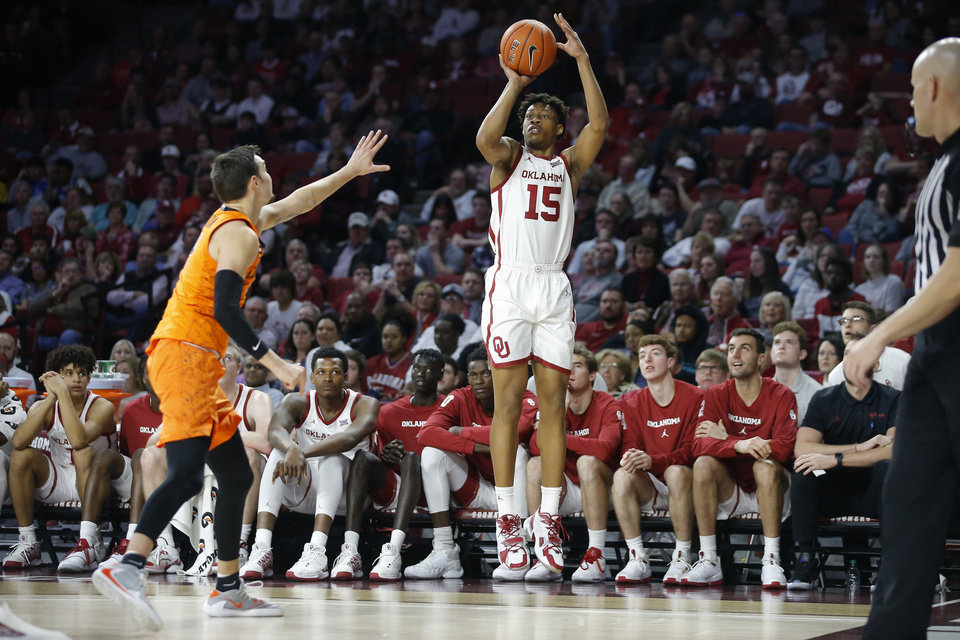 Photo - Oklahoma's Alondes Williams (15) makes a basket as Oklahoma State's Thomas Dziagwa (4) defends during a Bedlam college basketball game between the University Oklahoma Sooners (OU) and the Oklahoma State Cowboys (OSU) at the Lloyd Noble Center in Norman, Okla., Saturday, Feb. 1, 2020. Oklahoma won 82-69. [Bryan Terry/The Oklahoman]
