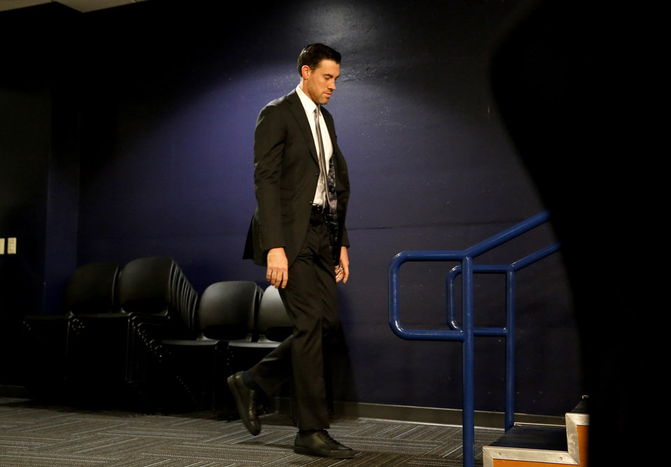 Photo - Nick Collison walks to the podium for a press conference before the NBA basketball game between the Oklahoma City Thunder and the Toronto Raptors at the Chesapeake Energy Arena, Wednesday,March 20, 2019. Photo by Sarah Phipps, The Oklahoman