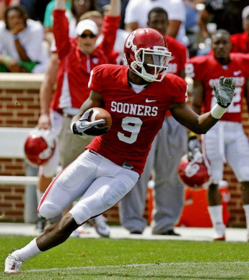 Gabe Lynn (9) intercepts a pass during the University of Oklahoma Sooner's (OU) Spring Football game at Gaylord Family-Oklahoma Memorial Stadium on Saturday, April 16, 2011, in Norman, Okla. Photo by Steve Sisney, The Oklahoman <strong>STEVE SISNEY</strong>