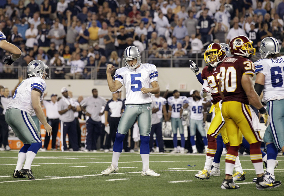 Dallas Cowboys kicker Dan Bailey reacts to scoring the game-winning field goal against the Washington Redskins during the second half of an NFL football game Monday, Sept. 26, 2011, in Arlington, Texas. The Cowboys won 18-16. (AP Photo/Tony Gutierrez)