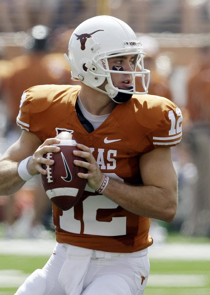 Photo - Texas quarterback Colt McCoy prepares to throw a pass against UTEP during the first quarter of an NCAA college football game in Austin, Texas, Saturday, Sept. 26, 2009. (AP Photo/Eric Gay) ORG XMIT: TXUT113