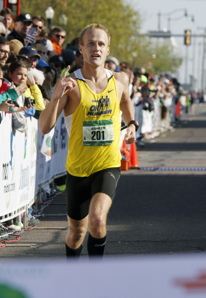 Photo - Jake Buhler wins the Oklahoma City Memorial Marathon in Oklahoma City, Sunday, April 28, 2013,  By Paul Hellstern, The Oklahoman