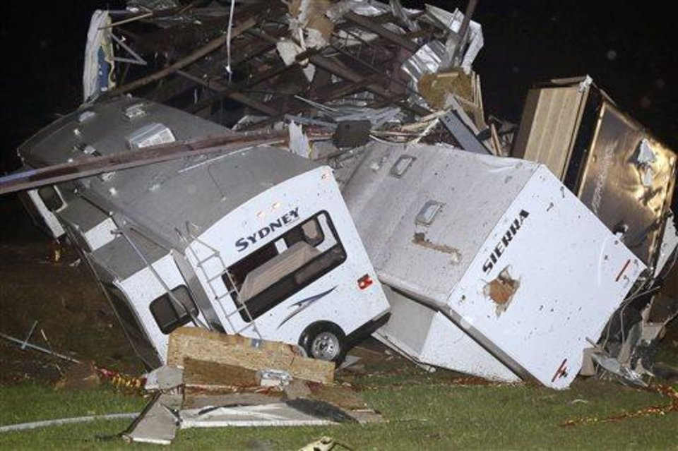 Photo - Travel trailers and motor homes are piled on top of each other at Mayflower RV in Mayflower, Ark., Sunday, April 27, 2014.A powerful storm system rumbled through the central and southern United States on Sunday, spawning tornadoes. (AP Photo/Danny Johnston)
