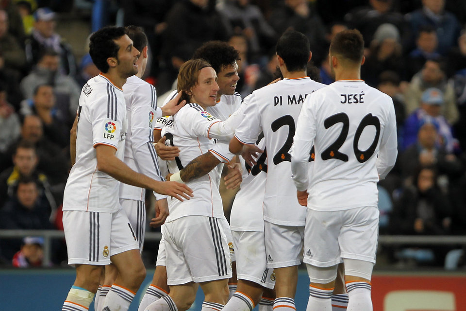 Photo - Real's Luka Modric, 3rd left, celebrates his goal with teammates during a Spanish La Liga soccer match between Real Madrid and Getafe at the Coliseum Alfonso Perez stadium in Madrid, Spain, Sunday, Feb. 16, 2014. (AP Photo / Gabriel Pecot)