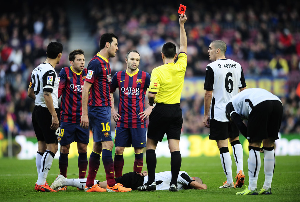 Photo - Referee shows a red card to FC Barcelona's Jordi Alba, second left, against Valencia during a Spanish La Liga soccer match at the Camp Nou stadium in Barcelona, Spain, Saturday, Feb. 1, 2014. (AP Photo/Manu Fernandez)