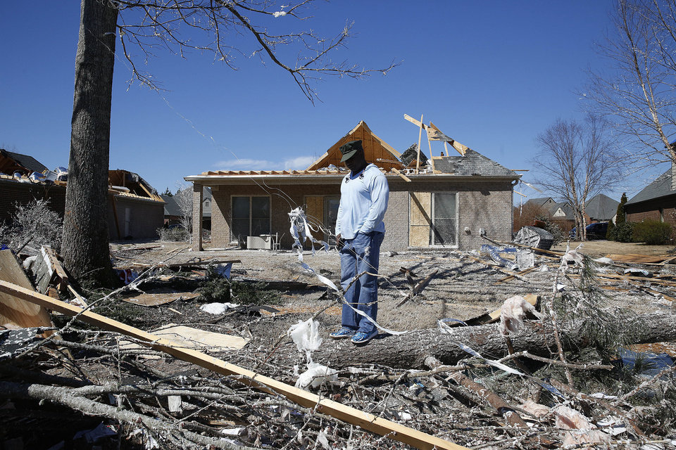 Photo - Maurell Campbell hangs his head, Wednesday, March 2, 2016, as he looks at the damage from storms that struck his friends home Tuesday evening in Bessemer, Ala. Campell says he feels lucky that his friends were not home during the tornado. Forecasters say a tornado that severely damaged homes and trees in the Birmingham suburb has been determined as an EF2, with winds of between 120 and 125 mph.   (AP Photo/Brynn Anderson)