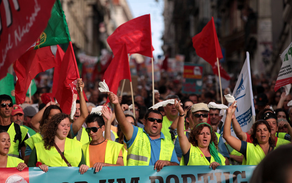 Demonstrators wave white tissues while demanding the government resignation during a protest march against unemployment heading to the Portuguese parliament in Lisbon and organized by workers' unions Saturday, Oct. 13 2012. Unemployment figures in Portugal have soared since the introduction of austerity measures to fight the country's debt crisis. (AP Photo/Armando Franca)