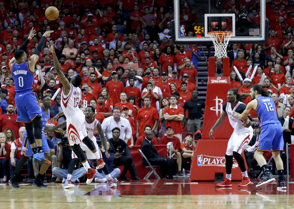 Photo - Oklahoma City's Russell Westbrook (0) shoots over Houston's James Harden (13) during Game 5 in the first round of the NBA playoffs between the Oklahoma City Thunder and the Houston Rockets in Houston, Texas,  Tuesday, April 25, 2017.  Houston won 105-99. Photo by Sarah Phipps, The Oklahoman