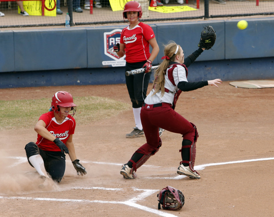 Photo - Purcell's Kaylin Taylor scores against Tuttle in the first round at the 2012 State Fast-Pitch Softball Tournament on Thursday, Oct. 11, 2012 at ASA Hall of Stadium in Oklahoma City, Okla.  Tuttlw catcher is Mackenzie McMurtry.  Photo by Steve Sisney, The Oklahoman