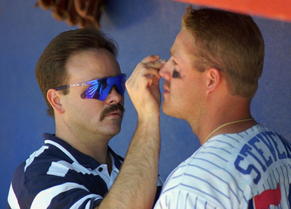 Oklahoma City 89ers baseball trainer Greg Harrel, left, is shown with first baseman Lee Stevens in 1996. JIM BECKEL - ARCHIVE PHOTO, JIM BECKEL