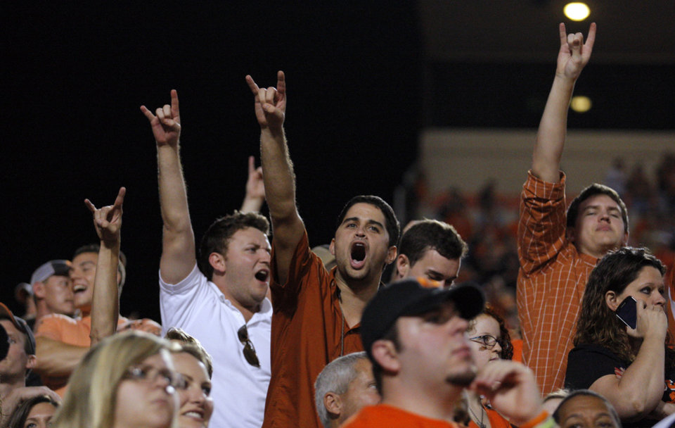 Photo - Texas fans celebrate during a college football game between Oklahoma State University (OSU) and the University of Texas (UT) at Boone Pickens Stadium in Stillwater, Okla., Saturday, Sept. 29, 2012. Texas on 41-36. Photo by Sarah Phipps, The Oklahoman