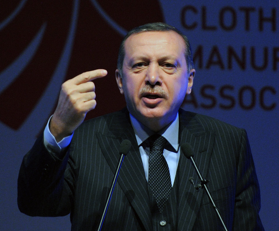 Photo -   Turkey's Prime Minister Recep Tayyip Erdogan speaks during a fashion conference in Istanbul, Turkey, Thursday, May 3, 2012. Erdogan on Thursday accused ratings agency Standard & Poor's of bias for lowering the country's long-term credit outlook on the same day it upgraded Greece's credit grade. (AP Photo)