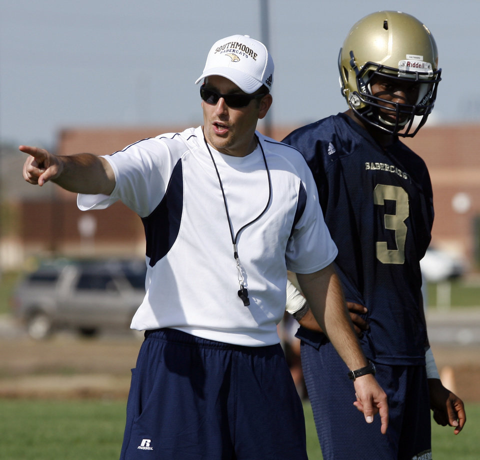 Photo - HIGH SCHOOL FOOTBALL PRACTICE: Jeff Brickman coaches receivers on Southmoore High School's first day of football practice in Moore, Okla. on Tuesday, Aug. 11, 2009.   At right is Brandon Hayward.    Photo by Steve Sisney, The Oklahoman ORG XMIT: KOD