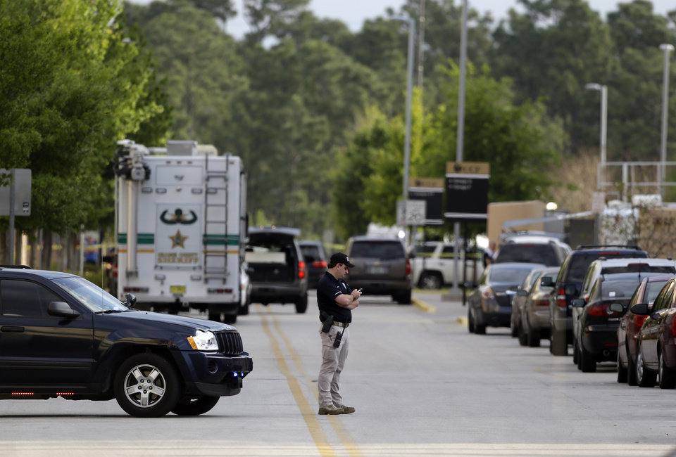 University of Central Florida police block off a street near the Tower 1 dorm after explosive devices were found while investigating a death in the dorm, Monday, March 18, 2013, in Orlando, Fla. Hundreds of students were evacuated, though the school said there was no immediate threat. (AP Photo/John Raoux)