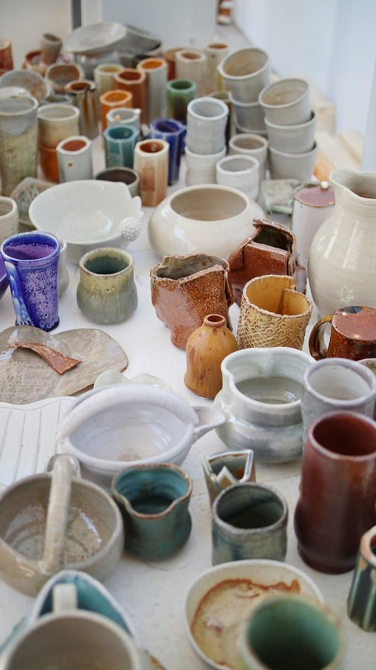 Photo - Finished pottery from test runs line a table inside the Ceramics Studio at Oklahoma Contemporary Arts Center's new Studio School Monday, March 9, 2020. [Photo by Doug Hoke/The Oklahoman]