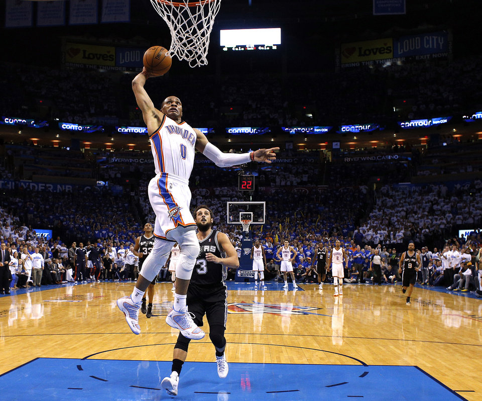 Photo - Oklahoma City's Russell Westbrook (0) dunks in front of San Antonio's Marco Belinelli (3) during Game 4 of the Western Conference Finals in the NBA playoffs between the Oklahoma City Thunder and the San Antonio Spurs at Chesapeake Energy Arena in Oklahoma City, Tuesday, May 27, 2014. Photo by Bryan Terry, The Oklahoman