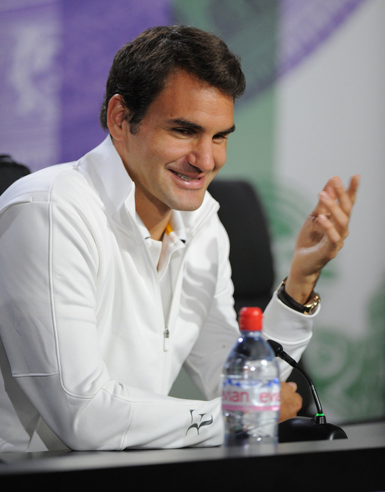 Photo - In this photo taken on Sunday, June 23, 2013 and made available by The All England Lawn Tennis & Croquet Club Wimbledon, defending men's champion Roger Federer of Switzerland, gestures during a press conference at Wimbledon. The Championships start Monday, with defending men's champion Roger Federer of Switzerland attempting to win the title for the eighth time. (AP Photo/Jon Buckle/AELTC)