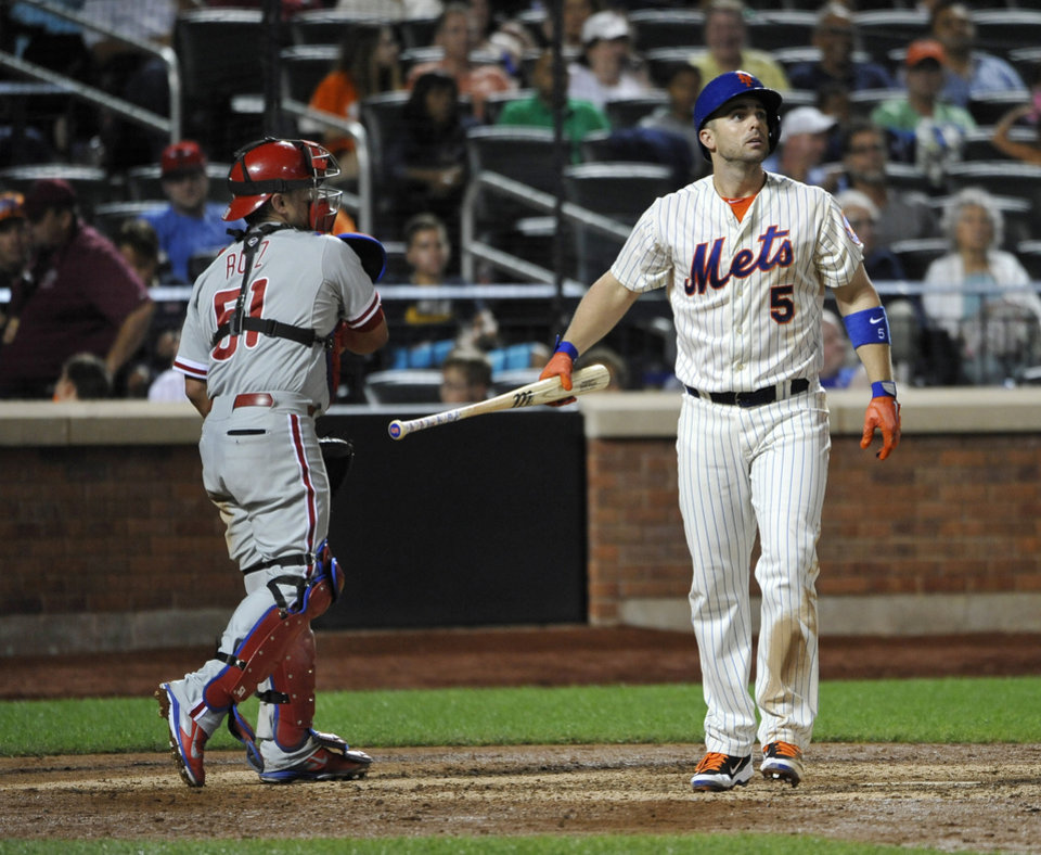 Photo - New York Mets' David Wright (5) reacts next to Philadelphia Phillies catcher Carlos Ruiz after striking out off of relief pitcher Ken Giles in the eighth inning of a baseball game at Citi Field on Saturday, Aug. 30, 2014, in New York. (AP Photo/Kathy Kmonicek)
