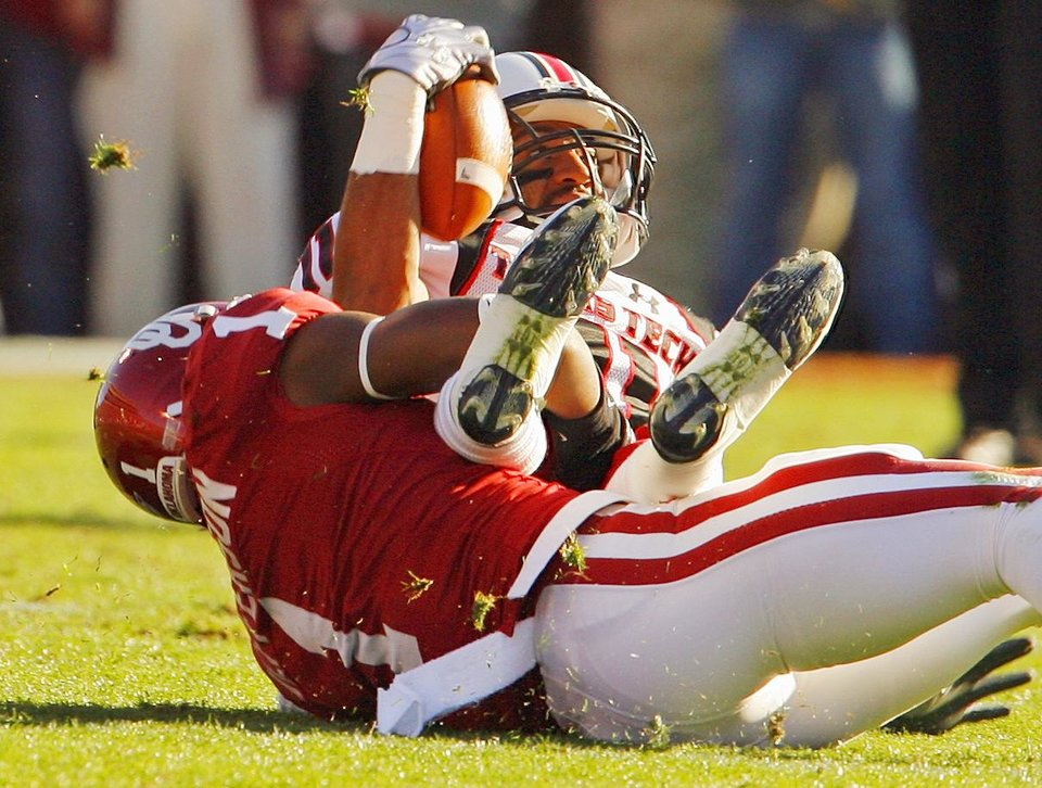 Photo - Tony Jefferson (1) brings down wide receiver Tramain Swindall (11) after a catch during the first half of the college football game between the University of Oklahoma Sooners (OU) and the Texas Tech Red Raiders (TTU) at the Gaylord Family Memorial Stadium on Saturday, Nov. 13, 2010, in Norman, Okla.  Photo by Steve Sisney, The Oklahoman