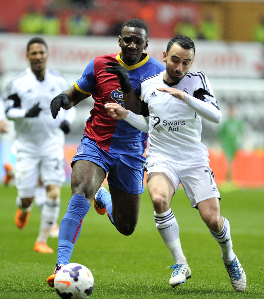 Photo - Swansea City' Leon Bitton (right) and Crystal Palace's Yannick Bolasie duel during theEnglish Premier League match at the Liberty Stadium, Swansea, Wales, Sunday March 2, 2014. (AP Photo/PA) UNITED KINGDOM OUT  NO SALES  NO ARCHIVE