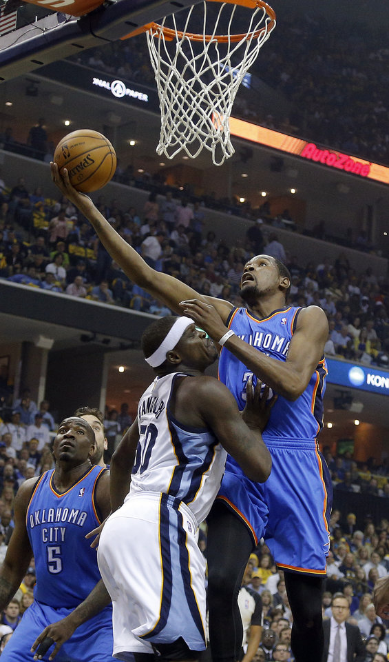 Photo - Oklahoma City's Kevin Durant (35) shoots a lay up as Memphis' Zach Randolph (50) during Game 6  in the first round of the NBA playoffs between the Oklahoma City Thunder and the Memphis Grizzlies at FedExForum in Memphis, Tenn., Thursday, May 1, 2014. Photo by Bryan Terry, The Oklahoman