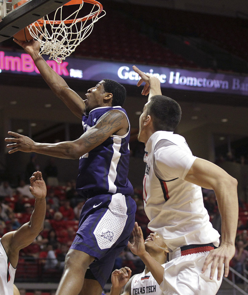Photo - TCU's Jarvis Ray scores over Texas Tech's Dejan Kravic during an NCAA college basketball game in Lubbock, Texas, Saturday, Feb, 1, 2014. (AP Photo/Lubbock Avalanche-Journal, Tori Eichberger) LOCAL TV OUT
