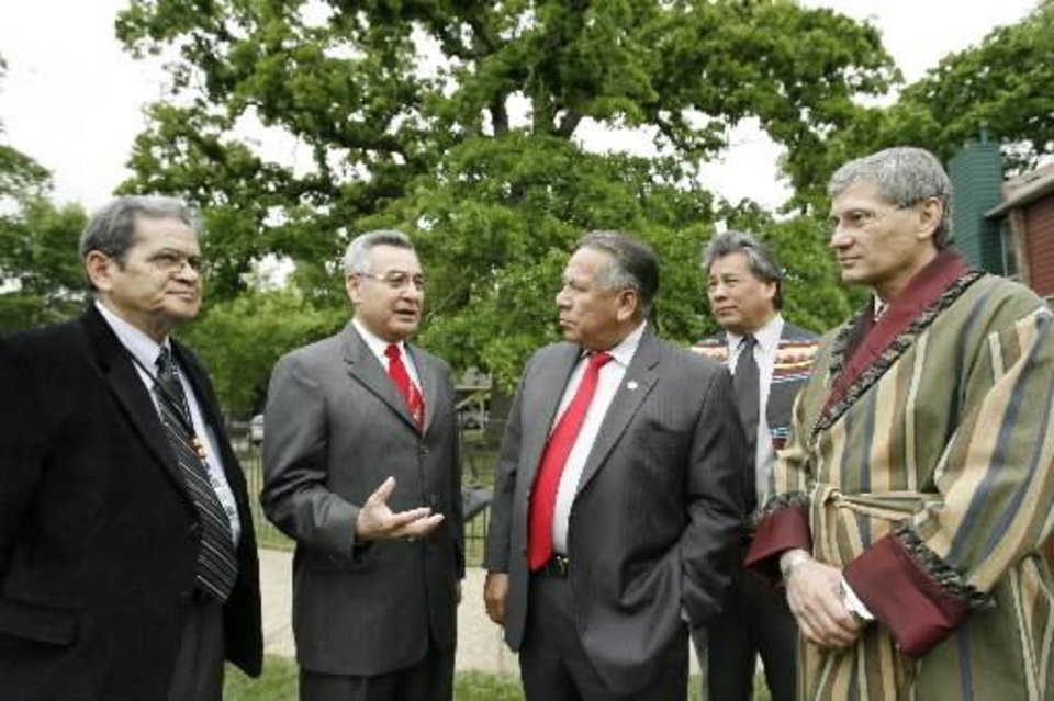 Tribal chiefs from four of the Five Civilized Tribes gather in Tulsa to commemorate the 100th anniversary of the Five Civilized Tribes Act of 1906 on Wednesday, April 26, 2006. Talking after the ceremony, from left, are A.D. Ellis, principal chief of the Muscogee Creek Nation;  Jefferson  Keel, lieutenant governor of the Chickasaw Nation; Enoch Kelly Haney, principal chief of the Seminole Nation; Larry Harrison, vice chief of the Seminole Nation, and and Chadwick Smith, principal chief of the Cherokee Nation. By Jim Beckel